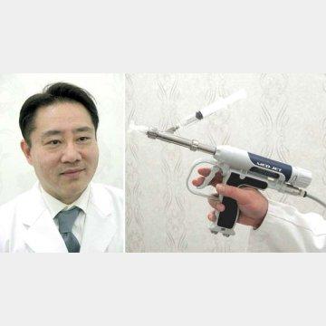 古賀祥嗣特別顧問(左)とAGA治療器